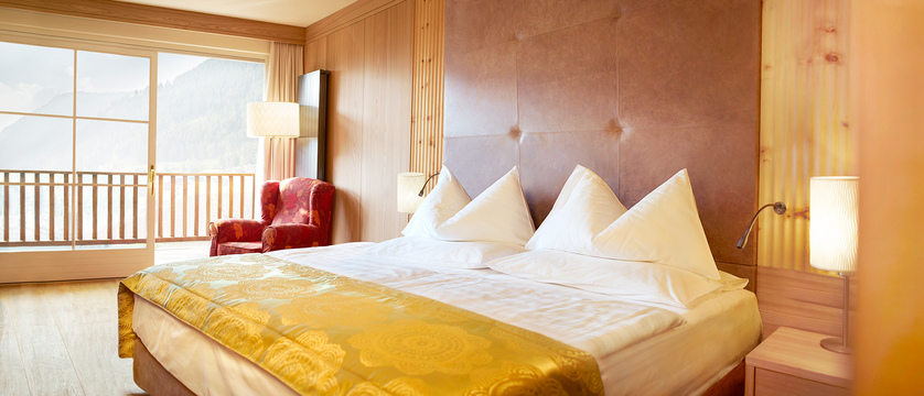 Italy_The-Dolomites-Ski-Area_Ortisei_hotel_adler_bedroom.jpg